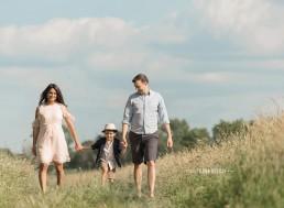 family walking in the sunshine