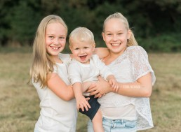 three siblings smiling