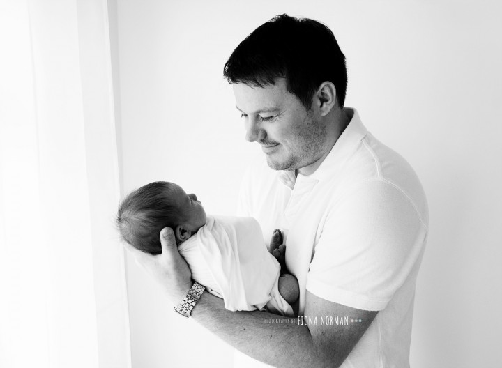 dad holding new baby girl