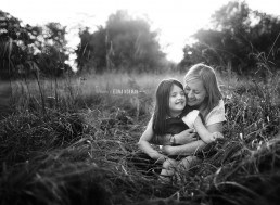 um and daughter in the field cuddling