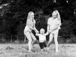 kids swinging together in field