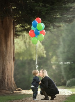 mother with a son and lots of balloons