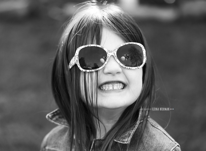 smiley girl with glasses on