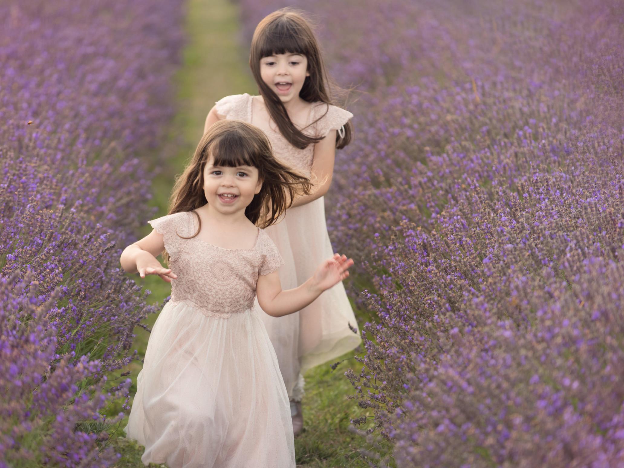 girls running in lavender
