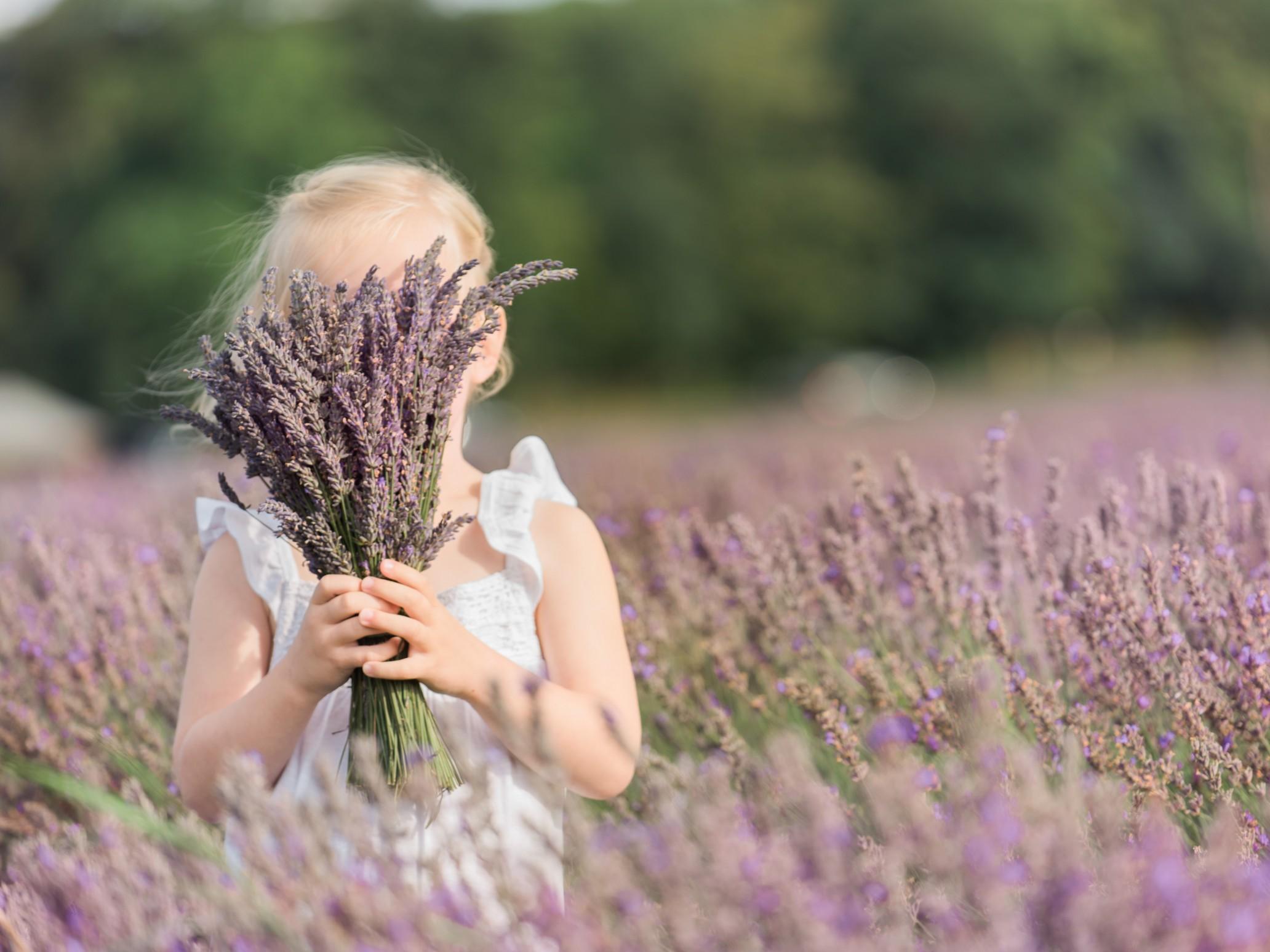 girl hiding behind lavender