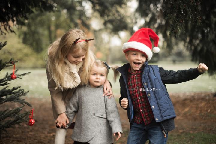siblings dancing at christmas