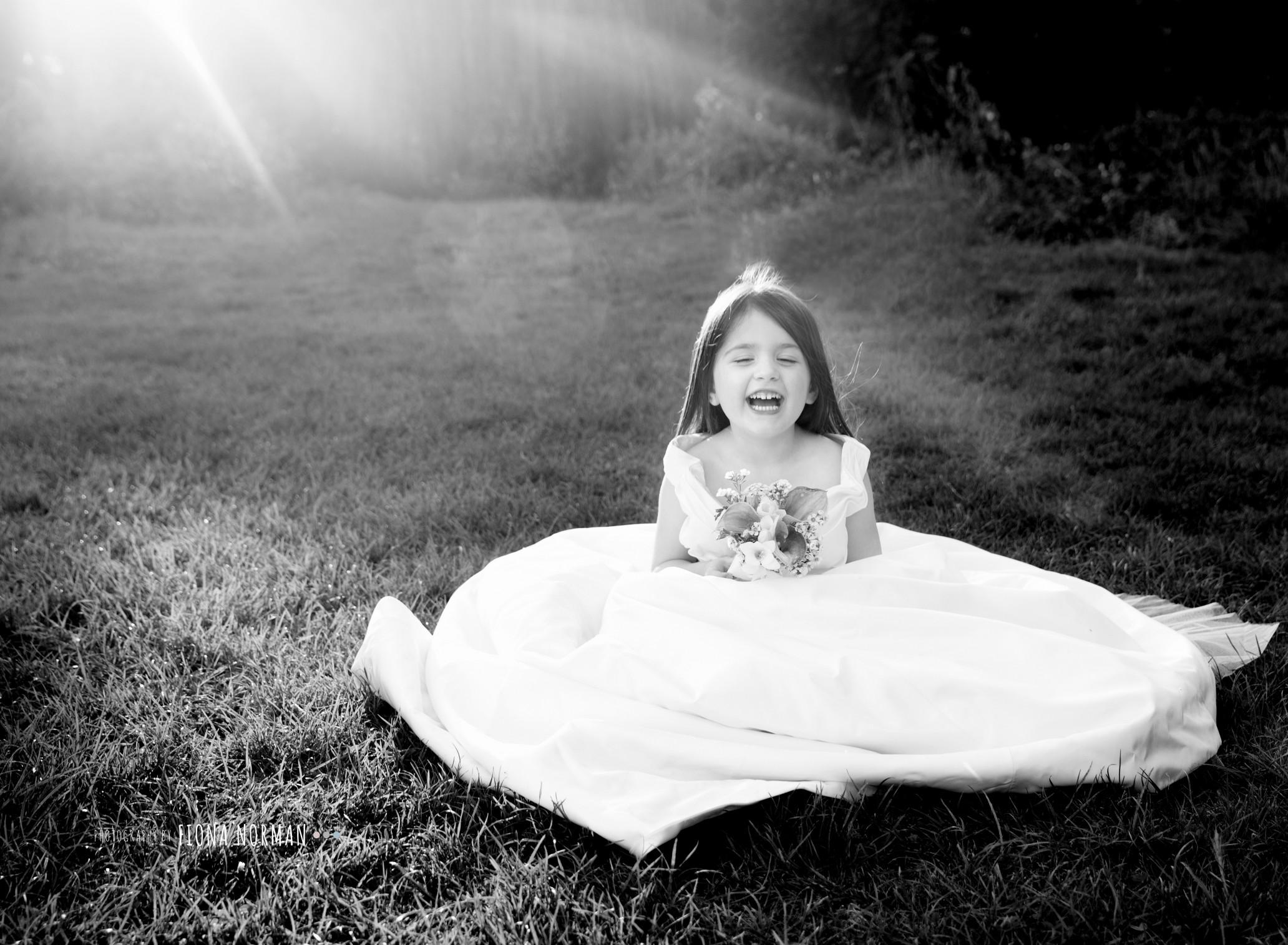 girl in wedding dress laughing