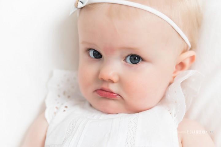 baby looking grumpy