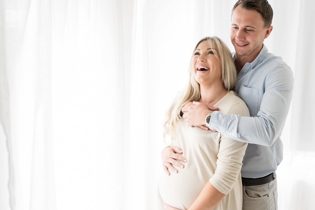 pregnant lady laughing with husband
