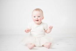 baby in tutu smiling