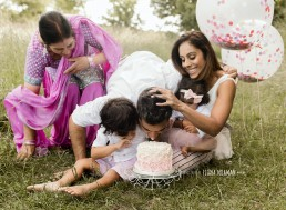 family smashing cake
