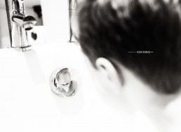 boy looking at his reflection in bath
