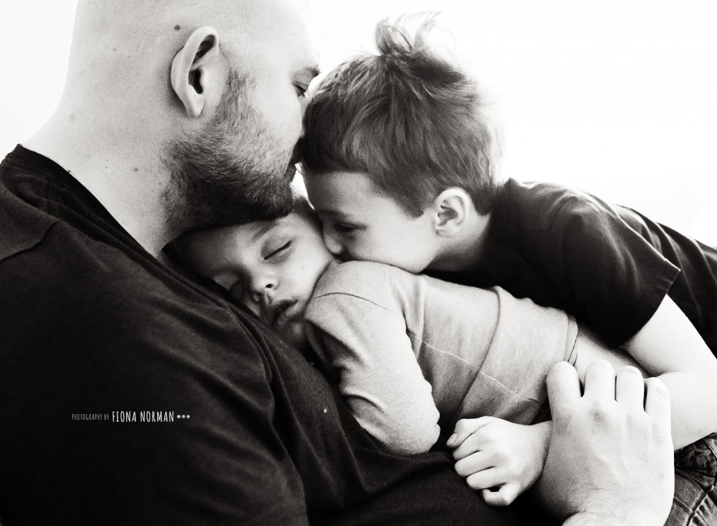 dad and sons cuddling