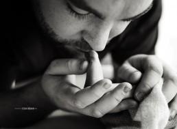 daddy kissing a newborn's feet