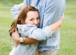 daughter hugging father