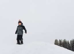 child on snowy mountain in lapland
